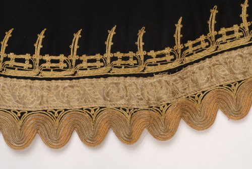 Detail of terzidikos (gold tailored) embroidery at the bottom of the overcoat, in the centre, succession of compositions